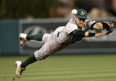 ANAHEIM, CA - APRIL 10: Second baseman Eric Sogard #28 of the Oakland Athletics dives but cant reach an RBI single hit by Hank Conger of the Los Angeles Angels of Anaheim in the eighth inning at Angel Stadium of Anaheim on April 10, 2013 in Anaheim, California. (Photo by Stephen Dunn/Getty Images)