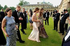 The friendly duchess found plenty of time to chat with her esteemed guests during the event held at Houghton House