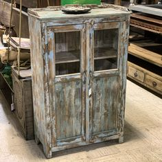 "Distressed Wood and Glass Cabinet Item 712190 Measures 32x14x50"" Priced at $372 - #shabbychicdecor #reclaimedwoodfurniture #reclaimedwood #cabinet #armoire #storage"