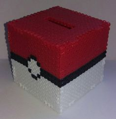 Perler bead coin box inspired by the popular RPG game, Pokemon. Saving up for all those full restores and max revives? Maybe youre preparing to go up against the Elite 4? Keep your Pokedollars safe in this nifty, easy to open money box! Youre Pokemon will be glad you did!  Each piece is made with time and care melted into each bead. Due to the nature of the beads, each piece melts differently and is never exactly like the one before it.  Every non-presprite item is originally designed by my…