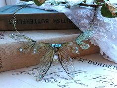 Beautiful delicate faerie winged necklace by UndertheIvy2 on Etsy