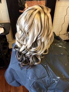 Heavy blonde highlight with black lowlights.