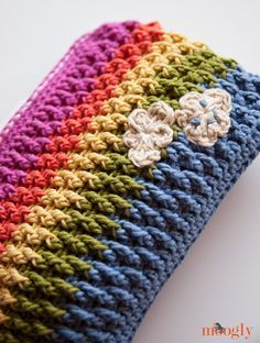 Rainbow Happy Fun Pouch :: Free Crochet Pattern Pattern is designed with no side seams and  no lining Zipper is attached to crochet