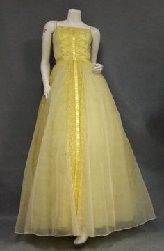 Vintageous, LLC - Sunny Yellow Chiffon 1960's Evening Gown w/ Embroidery, $180.00 (http://www.vintageous.com/sunny-yellow-chiffon-1960s-evening-gown-w-embroidery/)