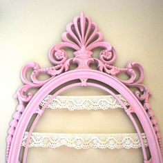 framed jewelry holder-- pick a color to paint it, attach lace strips, and hang the earrings!