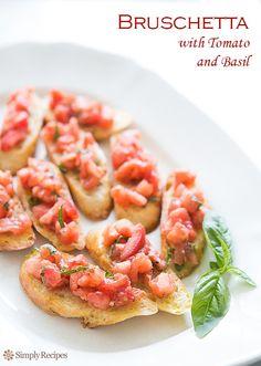 "Summery bruschetta (pronounced ""brusketta"") with tomatoes, basil, and garlic on SimplyRecipes.com #vegan"
