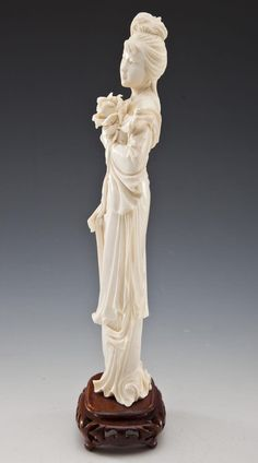 Carved ivory figure of a woman.