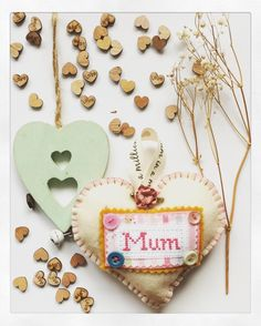 A personal favourite from my Etsy shop https://www.etsy.com/uk/listing/510513972/custom-made-mum-cream-felt-hanging-heart