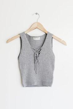 """Details Size Shipping • 85% Rayon 12% Polyester 3% Spandex • Rib knit lace up top • Hand Wash • Line dry • Made in the U.S.A • Measured from small • Length 15"""""""