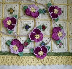 Crochet pansies. Free pattern from here: http://web.archive.org/web/20070824234331/http://www.countryyarns.com/pansy.htm