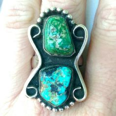 "Vtg Huge Dead Pawn Navajo Nevada Turquoise Ring Vintage Huge Dead Pawn Royston Nevada Green and blue Navajo Sterling Turquoise Ring. This ring is so large, it goes from the base of my finger to my knuckle! Made of two rough Royston Turquoise stones set in finely crafted Navajo Sterling Silver. Age has worn away and a markings, but it tests positive for sterling, and was created by a master craftsman. It measures approximately 1""5"" long x 1"" at its widest. Size 9. 14 grams. Excellent…"