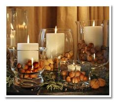 What a simple and elegant way to create autumnal ambiance! Bet I could find those glass holders at the Dollar Tree, no less.