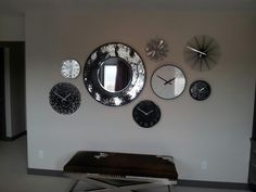 Have a wall you don't know what to do with? Try a grouping of funky clocks like in our Nolan Hill showhome.  http://www.shanehomes.com/shane/ShowHomes/212