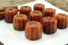 several cannelés on a plate - Buy this stock photo and explore similar images at Adobe Stock Cocktail Videos, Cocktail Photography, Halloween Cocktails, Whiskey Cocktails, I Love Food, Biscuits, Food Inspiration, Muffin, Food And Drink