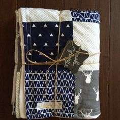 Incredibly soft white dimple dot Minky on one size, and geometric prints in a patchwork design on the other--this beautiful baby quilt will be