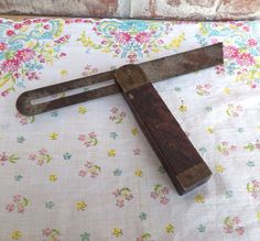 Check out this item in my Etsy shop https://www.etsy.com/listing/181164339/antique-brass-wood-adjustable-sliding-t