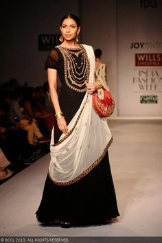 Candice Pinto showcases a creation by fashion designer Joy Mitra at the Wills Lifestyle India Fashion Week (WIFW) Spring-Summer 2014, held in Delhi.