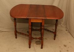 """Expandable drop leaf table having two 16"""" leaves 38""""x16""""x30""""T."""