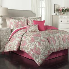Breathe new life into your bedroom decor with the Traditions by Waverly Lyrical Legend comforter collection. This beautiful ensemble features an intricate paisley pattern in rich jewel tones of radish red, seafoam green, citrine yellow, charcoal grey and ivory.  Large decorative pillow features red pleated face and solid red reverse, small decorative pillow features paisley face and red reverse. Comforter, shams and bed skirt are machine washable. Wash in cold water on the gentle cycle and…