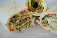 Tortilla Rollups - flavored cream cheese, chopped veggies, shredded cheese, turkey, ranch dressing, and greens