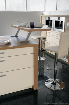 #Kitchen Idea of the Day: Modern Two-Tone Kitchen (By ALNO, AG) with a nice kitchen island bar for two.