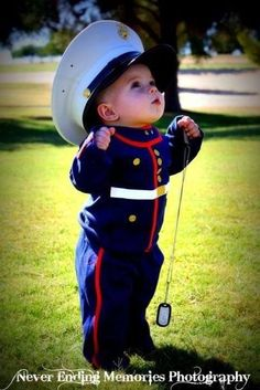 If I have a son I would like to get a photo like this with him holding my grandpas marine picture