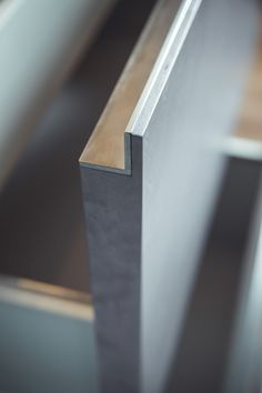 INTERIOR-iD - The sides of the timber drawers and brush stainless steel trim to the internal rim, have been beautifully mitred together.
