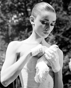 Audrey Hepburn photographed by Willy Rizzo during the filming of Funny Face, June 1956.