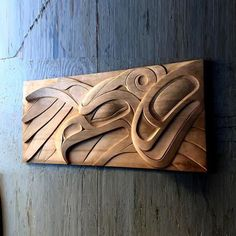 Wood Haida carving hanging on a wall. I don't know whose artwork this is but it is extraordinary!