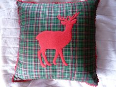 I get such a warm feeling when I see this cushion. Stag on tartan with pompom trim.  Must Have Designs