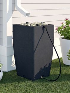 Conserve your water usage in the yard with help from a rain barrel. Check out this modern matte black rain barrel, and see other stylish options that will look good in your yard. Modern Rain Barrels, Decorative Rain Barrels, Rain Barrel System, Rain Water Barrel, Fix Squeaky Floors, Water Collection, Rainwater Harvesting, Water Conservation, Home Repair