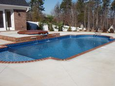 Charlotte Pool Photos, Vinyl Pool Photos - geometric pool with tile coping and tanning shelf