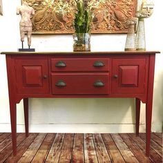 Beautiful custom red created on a sideboard was created by mixing Primer Red and Emperor's Silk Chalk Paint® decorative paint by Annie Sloan. This rich red was then finished with Clear and Black Chalk Paint® Wax. Gorgeous project by Bordentown, NJ stockist Soldier 58.