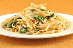 Linguine with Spinach and Mascarpone Cream: Linguine tossed with fresh spinach and a simple, creamy sauce made with mascarpone cheese makes a delicious meatless meal in very little time.