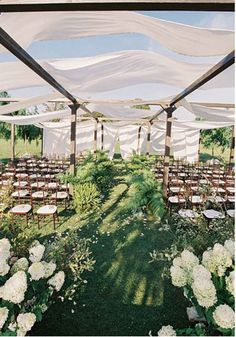 Vermont Wedding: For a wedding in Stowe, Vermont, Helmstetter built a reclaimed-wood structure in the middle of an open field to create a hidden-garden feeling for the ceremony.