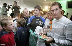 Miroslav Klose of Germany signs autographs during a visit from schoolchildren at the Bremer Weserstadion on August 26, 2005 in Bremen, Germany.