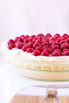 Showcase the first raspberries of spring with this luscious Raspberry Meringue Pie. A golden meringue crust is filled with lemon custard, then topped with sweetened berries folded into whipped cream. Naturally gluten free.  #berriesofspring