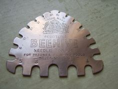 An Antique/Vintage 'Beehive' Knitting Needle Gauge 'Patons & Balwins Wools - Britain's Best' Circa 1940's