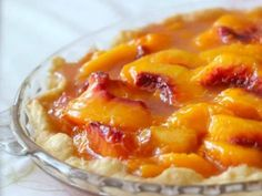 Health Nut Peach Pie Serves 8 Ingredients: Crust 2 1/4 cups finely ground blanched almonds (although you could also use pecans, walnuts, or even macadamia nuts) 1/2 teaspoon ground cinnamon 1/4 cup melted butter 2 tablespoons pure maple syrup Filling 6 or 7 ripe peaches, pitted and sliced (I don't peel mine but you can, if you like. You may also use frozen peaches if they're not in season) 2 tablespoons lemon juice 2 tablespoons butter 2 tablespoons maple syrup, rice syrup, agave syrup ...