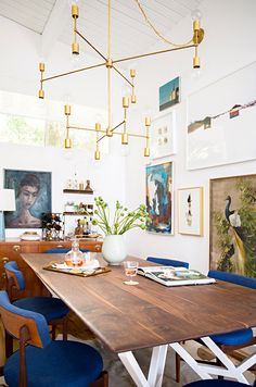 modern dining space with gallery wall