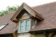 Border Oak - Painted window frames contrast beautifully with the oak beams and roof tiles.