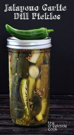 Jalapeno Garlic Dill Pickles - Refrigerator - Trending Refrigerator for sales. - Jalapeno Garlic Dill Pickles on The Creekside Cook Canning Pickles, Canning Jars, Canning Recipes, Canning 101, Spicy Pickle Recipes, Hot Garlic Dill Pickle Recipe, Mason Jars, Jalapeno Recipes, Kitchen Recipes