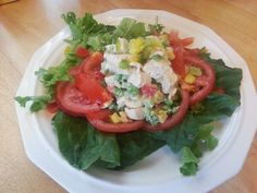 Chicken Salad with peas, peppers, and celery; over romaine lettuce, spinach and sliced tomatoes.