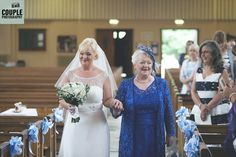 A happy bride walking down the aisle with her mother. Weddings at The Johnstown Estate, photographed by Couple Photography.