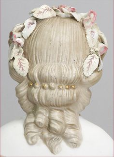 queen Eugenie, Parian shoulder headed doll, 55 cm, blue painted eyes, closed mouth, fine modelled hair, with floral decorations,
