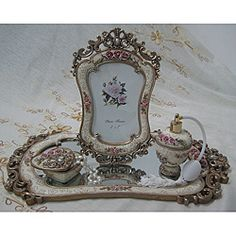 @Overstock.com - Antique Finish Vanity Dresser Set  - Color:  Antique finish with pink accentsSet includes: Mirror, frame, jewelry box, sprayerMaterials: Resin  http://www.overstock.com/Gifts-Flowers/Antique-Finish-Vanity-Dresser-Set/6204020/product.html?CID=214117 $48.99