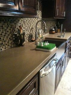 Concrete Countertops.  Looks nice! (Getting ideas to possibly redo counters before we move)