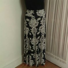 Black and White Maxi! Bobeau black and white printed maxi skirt...96% Rayon/4% Spandex.  Very soft and comfortable!  Perfect for the office...or summer picnic!  Received as a gift...Tried on but never worn beyond that. Bobeau Skirts Maxi
