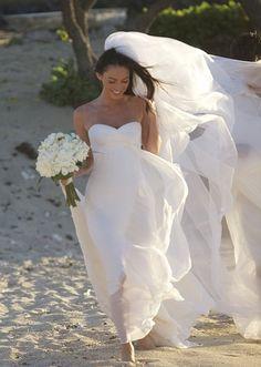 Megan Fox Beach Wedding dress .not feeling that dress but she would look good in a bin bag