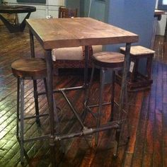Pipe Base Pub Table With Reclaimed Wood Top by Steven Garceau